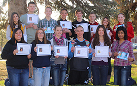 SUCCESS students, each holding several award certificates